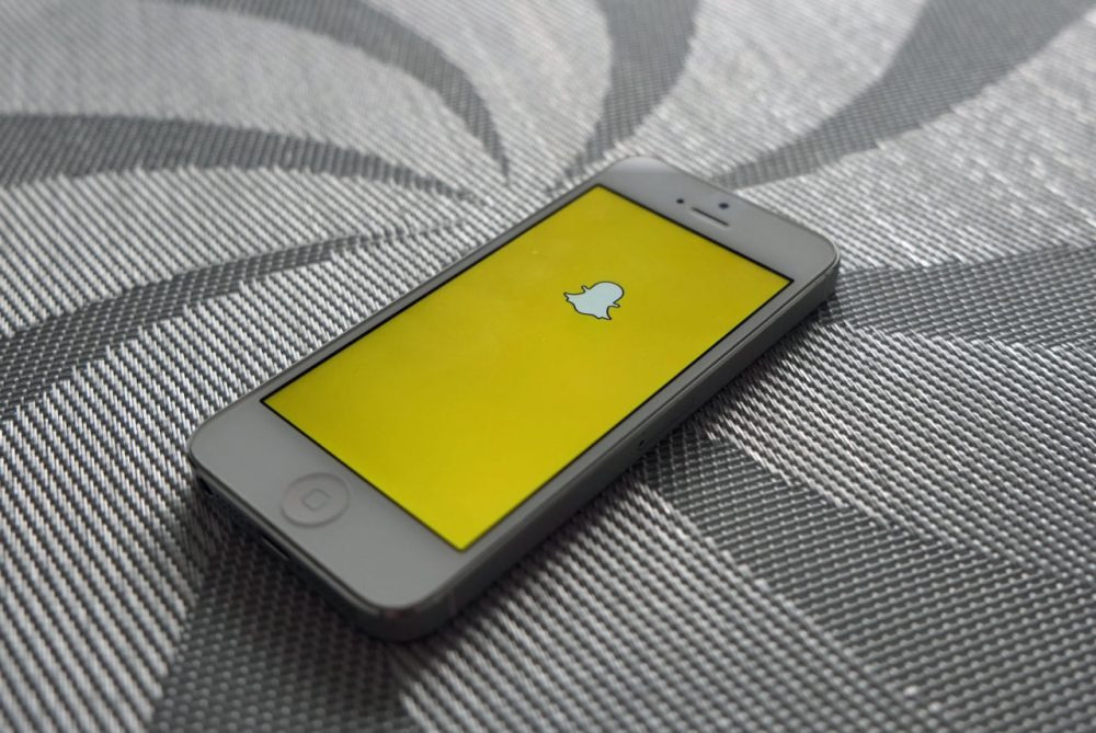 The Snapchat logo is pictured on an iPhone. (Adam Przezdziek/Flickr)