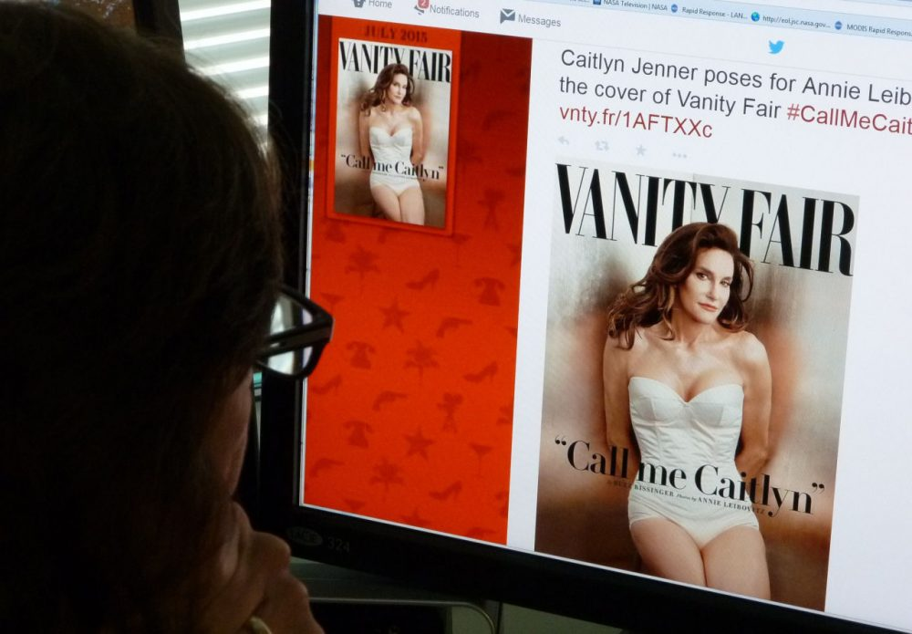 """In this June 1, 2015 photo, a journalist looks at Vanity Fair's Twitter site with the Tweet about Caitlyn Jenner, who will be featured on the July cover of the magazine. Caitlyn Jenner, the transgender Olympic champion formerly known as Bruce, on Monday unveiled her new name and look in a sexy Vanity Fair cover shoot -- drawing widespread praise, including from the White House. Lesbian, gay, bisexual and transgender campaigners -- and many well-wishers -- welcomed the high-profile debut, as did the 65-year-old Jenner's family, which includes the media-savvy celebrity Kardashian clan. """"I'm so happy after such a long struggle to be living my true self,"""" Jenner wrote in her first tweet after the magazine released the July cover photo by renowned photographer Annie Leibovitz. (Mladen Antonov/AFP/Getty Images)"""
