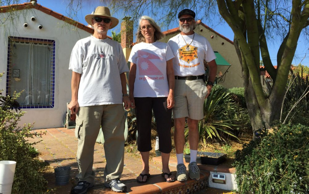 Transition Streets San Diego members Gawain Thompson, and Leslie and Jamie Edmonds stand in front of the Edmonds' home in El Cerrito, California. (Robin Young/Here & Now)