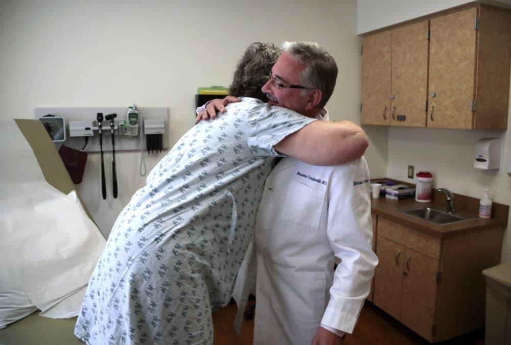 Patient Carole Linderman hugs Dr. Massimo Cristofanilli before her blood is drawn for a liquid biopsy. (Jacqueline Larma/AP)