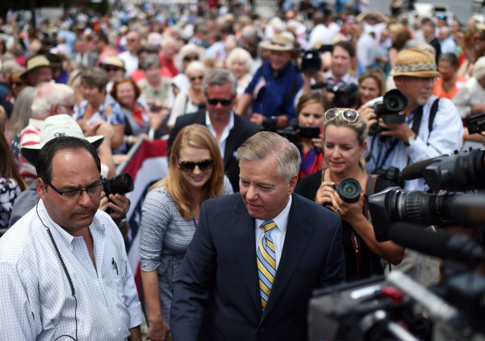 Sen. Lindsey Graham, R-S.C., center, greets supporters after announcing his bid for presidency, Monday, June 1, 2015, in Central, S.C. (Rainier Ehrhardt/AP)