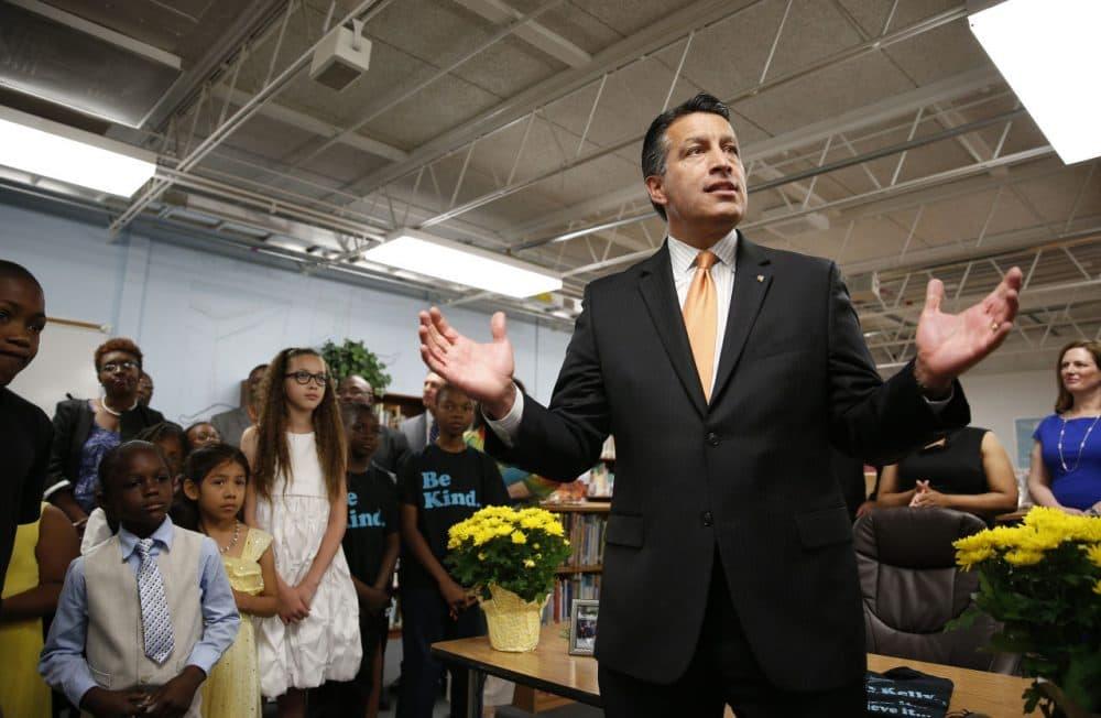 Nevada Governor Brian Sandoval, right, holds a bill signing ceremony Wednesday, June 3, 2015, in Las Vegas. (John Locher/AP)