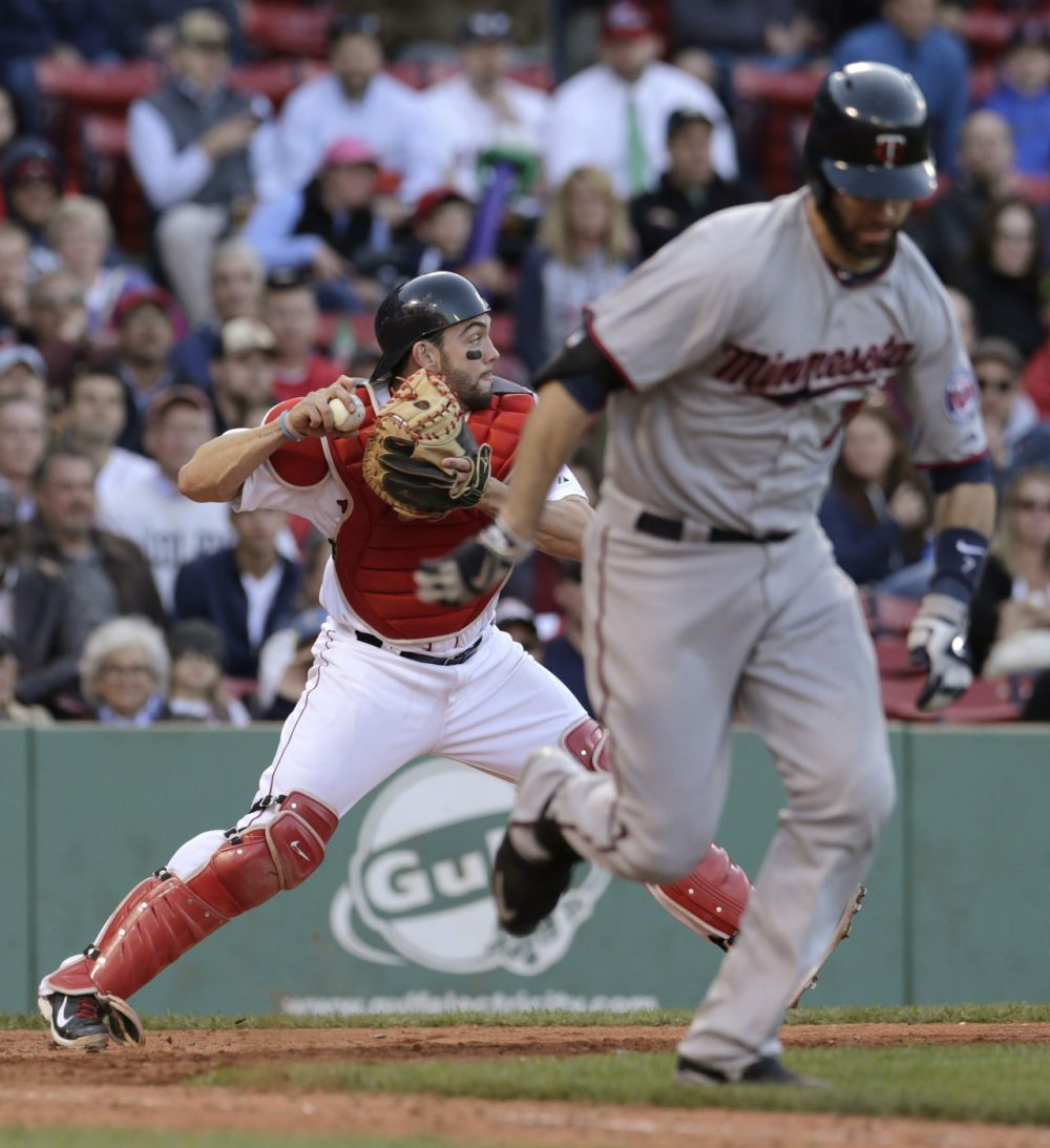 Boston Red Sox catcher Blake Swihart, left, throws to third baseman Pablo Sandoval after a bunt by Minnesota Twins' Joe Mauer during the ninth inning of a game at Fenway on Thursday, June 4, 2015, in Boston.  (Charles Krupa/AP)