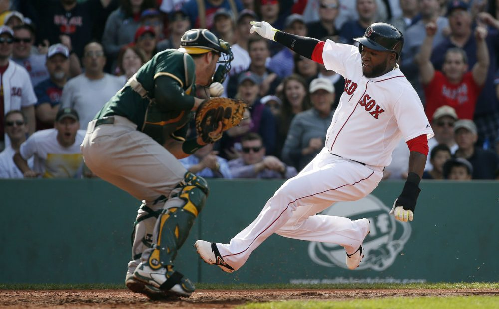 Boston Red Sox's David Ortiz scores on a single by Mike Napoli. (Michael Dwyer/AP)