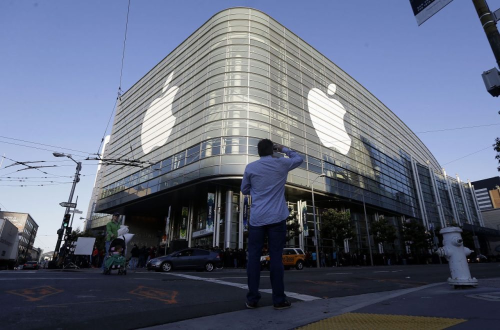 Apple logos adorn the exterior of the Moscone West building on the first day of the Apple Worldwide Developers Conference in San Francisco, Monday, June 8, 2015. The maker of iPods and iPhones is expected to announce its new, paid streaming-music service to launch this summer. (Jeff Chiu/AP)