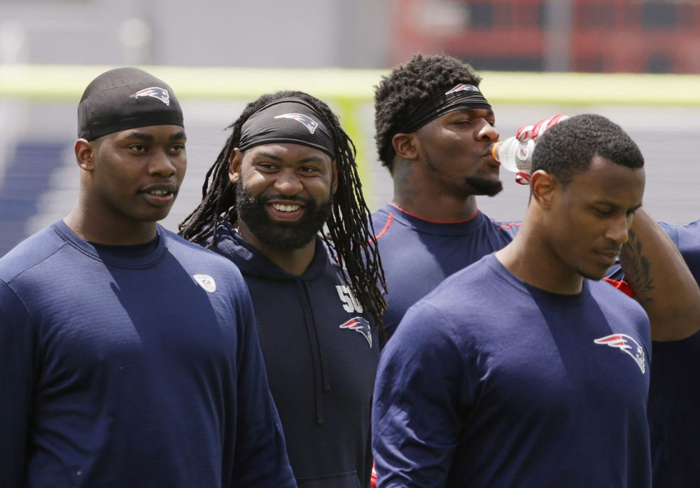 New England Patriots linebacker Brandon Spikes (second from left) smiles after an organized team activity on June 4. (Stephan Savoia/AP)