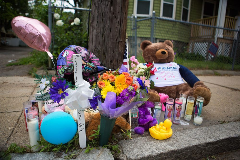 A memorial set up for 8-year-old hit and run victim Yadielys Deleon Camacho is seen Monday near the accident scene on West Selden Street in Mattapan. The accident happened Saturday. (Jesse Costa/WBUR)