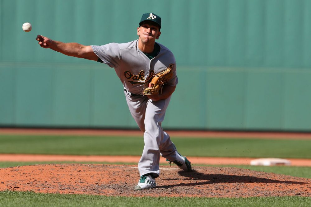 Pat Venditte of the Oakland Athletics throws in the eighth inning against the Boston Red Sox at Fenway Park on June 7, 2015 in Boston, Massachusetts.  ( Jim Rogash/Getty Images)
