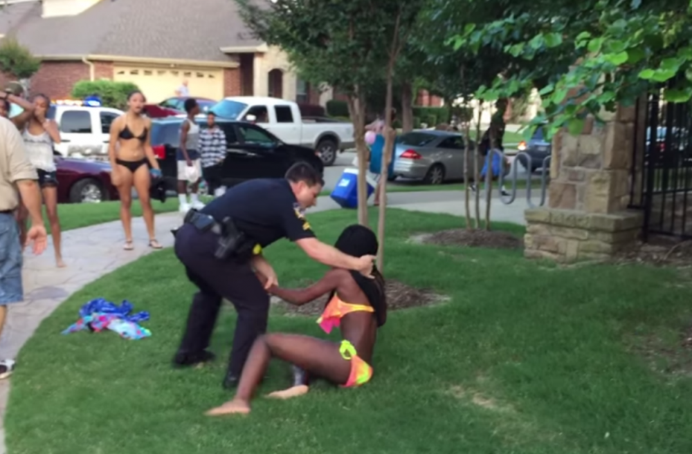 In this screenshot from YouTube, police officer Eric Casebolt pushes a 14-year-old girl to the ground.