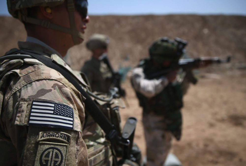 U.S. Army trainers watch as an Iraqi recruit fires at a military base on April 12, 2015 in Taji, Iraq. U.S. forces, currently operating in 5 large bases throughout the country, are training thousands of Iraqi Army combat troops, trying to rebuild a force they had originally trained before the U.S. withdrawal from Iraq in 2010. Members of the U.S. Army's 5-73 CAV, 3BCT, 82nd Airborne Division are teaching members of the newly-formed 15th Division of the Iraqi Army, as the Iraqi government launches offensives to try to recover territory lost to ISIS last year. (John Moore/Getty Images)