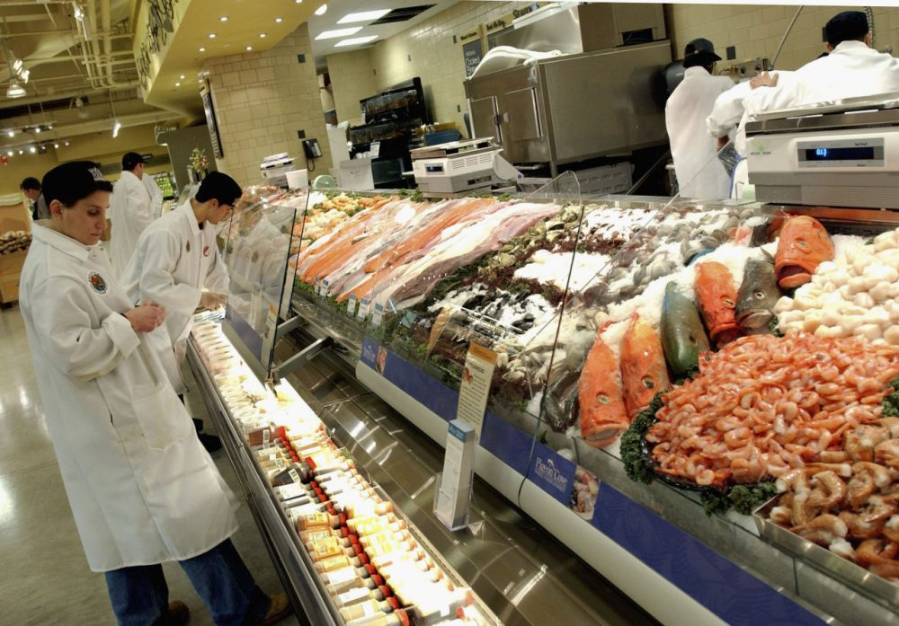 Clerks prepare the fish selling department at Whole Foods Market in New York City.  (Stephen Chernin/Getty Images)