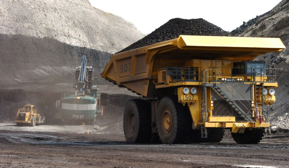 A truck carrying 250 tons of coal hauls the fuel to the surface of the Spring Creek mine near Decker, Montana. (Matthew Brown/AP)