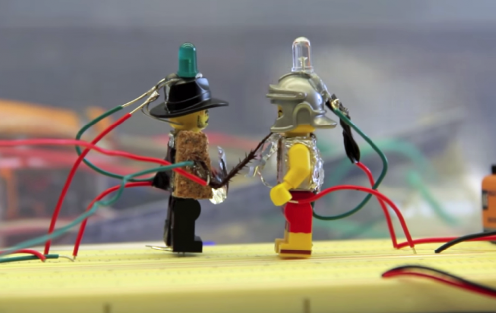Lego figures prepare to battle with cockroach legs. (Screenshot)