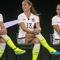 From left, U.S. team members Tobin Heath, Alex Morgan and Sydney Leroux pose in the a new black and white home uniforms for the U.S. Women's World Cup soccer team at a news conference in Los Angeles Wednesday, April 22, 2015. (Nick Ut/AP)