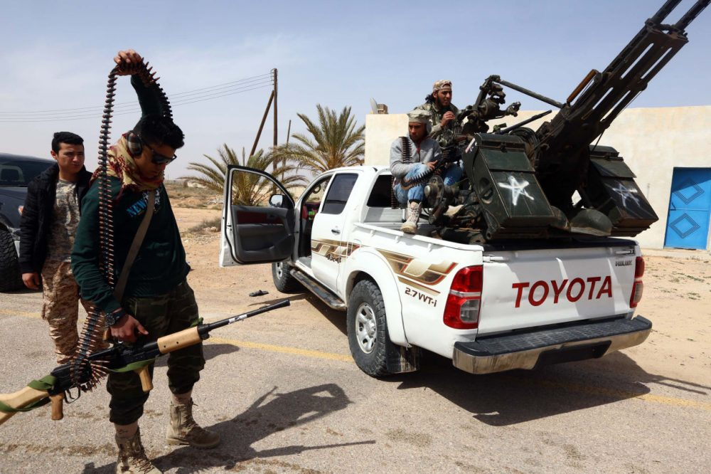 Members of forces loyal to Libya's Islamist-backed parliament General National Congress (GNC) prepare to launch attacks as they continue to fight Islamic State (IS) group jihadists on the outskirts of Libya's western city of Sirte on March 16, 2015. (Mahmud Turkia/AFP/Getty Images)