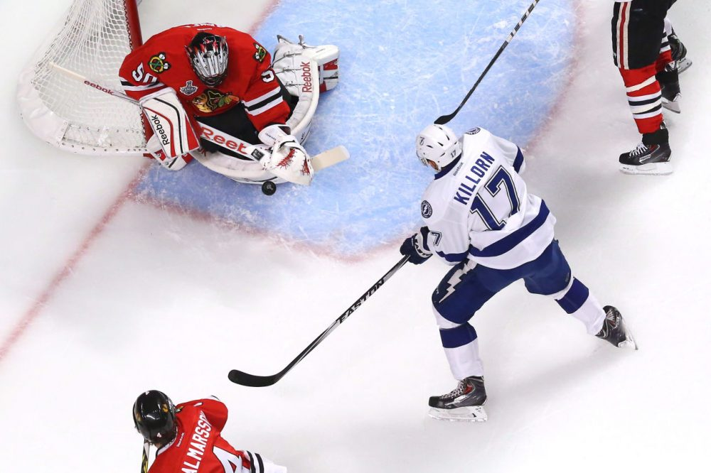 Corey Crawford #50 of the Chicago Blackhawks makes a save against Alex Killorn #17 of the Tampa Bay Lightning during Game Four of the 2015 NHL Stanley Cup Final at the United Center on June 10, 2015 in Chicago, Illinois. (Bruce Bennett/Getty Images)