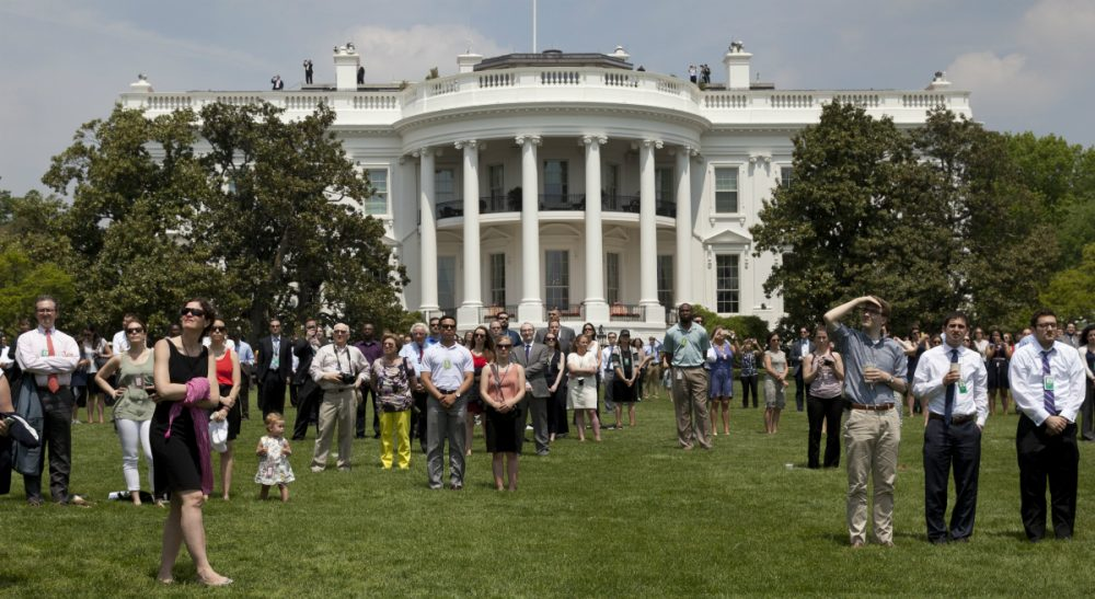 Janna Malamud Smith: If this nation is truly a democracy, why not let our citizens give governing a try? In this photo, people gather on the South Lawn of the White House, Friday, May 8, 2015, to watch Vintage military aircraft from World War II fly over Washington to mark the 70th anniversary of Victory in Europe Day. (AP Photo/Carolyn Kaster)