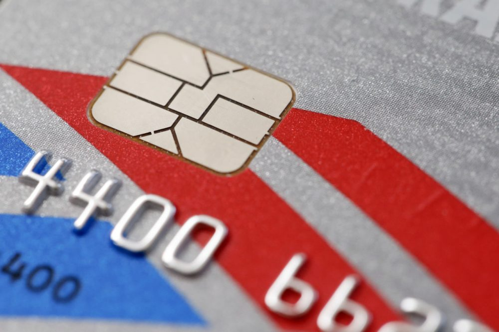 A chip-based credit card, in Philadelphia. U.S. banks, tired of spending billions a year to pay back fleeced consumers, are in the process of replacing tens of millions of old magnetic strip credit and debit cards with new cards that are equipped with computer chips that store account data more securely. (Matt Rourke/AP)