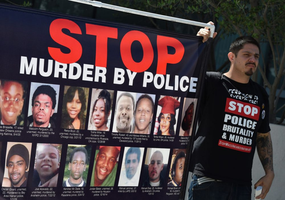 Members of Stop Mass Incarceration Network and other civil rights advocates protest outside LAPD headquarters after a homeless man known as 'Africa' was controversially shot dead by police in Los Angeles, California on March 7, 2015. (Mark Ralston/AFP/Getty Images)