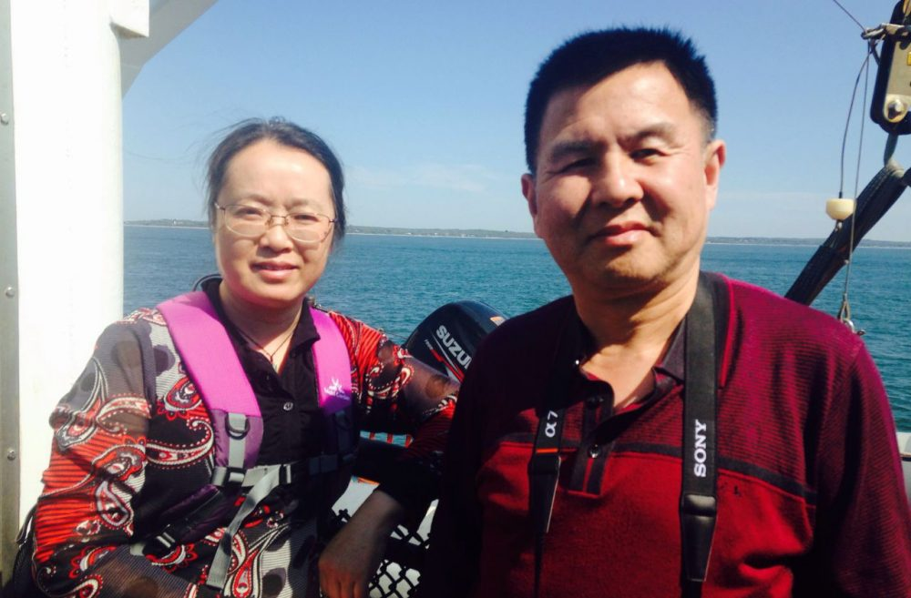 Chinese tourists Zhang Jie and He Anrong pose for a photo on the ferry to Martha's Vineyard, off the coast of Massachusetts. (Peter O'Dowd)