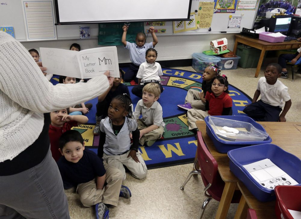 Kindergarten students listen as their teacher explains the day's activities to them at George Buck Elementary School in Indianapolis. (AJ Mast/AP)