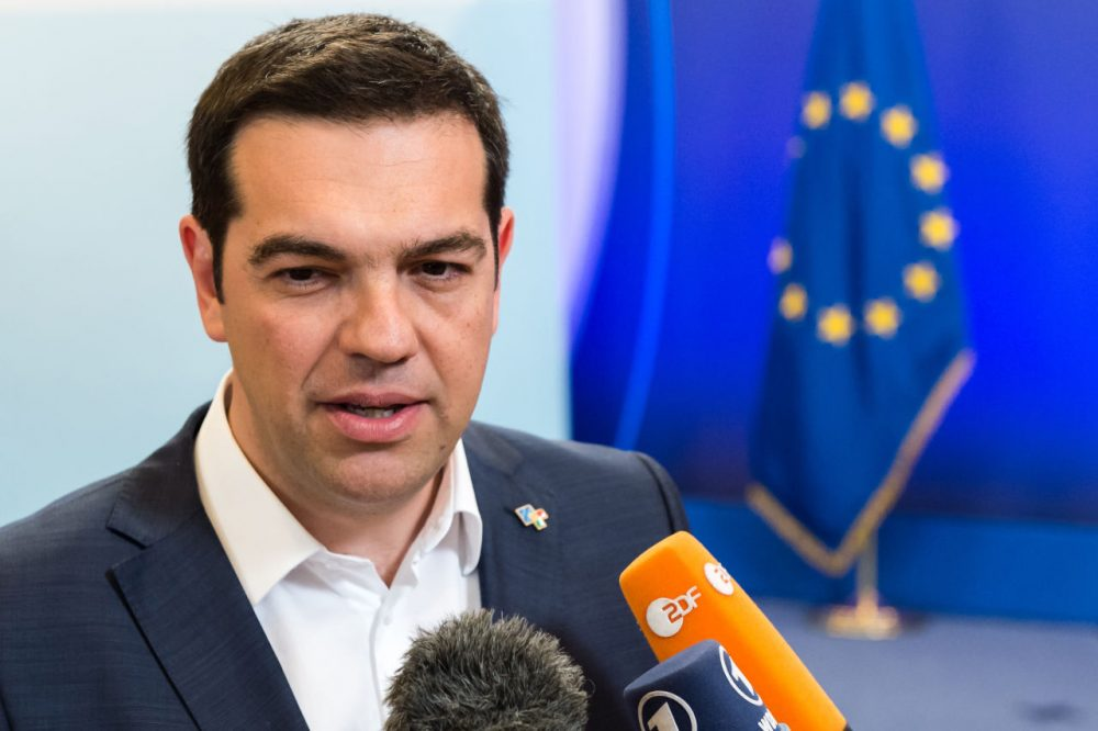 Greek Prime Minister Alexis Tsipras talks to the media as he leaves after he participated in a bilateral meeting with European Commission President Jean-Claude Juncker on the sidelines of the EU meetings in Brussels on Thursday, June 11, 2015. (Geert Vanden Wijngaert/AP)