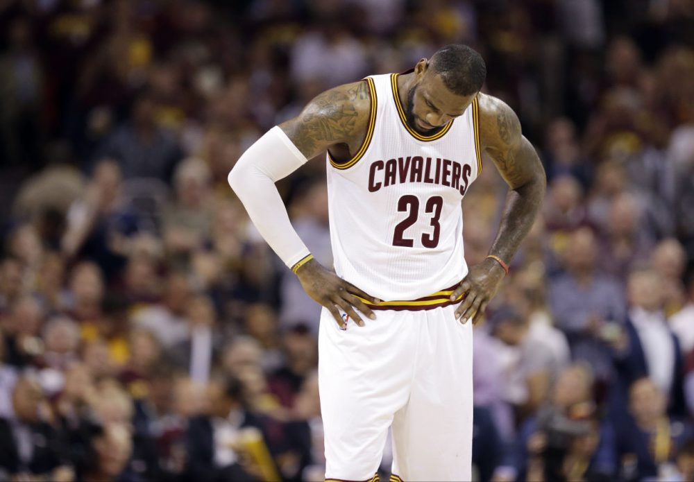 Cleveland Cavaliers forward LeBron James hangs his head during the second half of Game 6 of basketball's NBA Finals against the Golden State Warriors in Cleveland Tuesday. (Tony Dejak/AP)