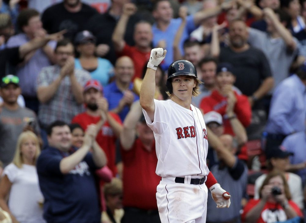 Boston Red Sox's Brock Holt gestures after hitting a triple in the eighth inning of the game against the Atlanta Braves at Fenway Park Tuesday, June 16, 2015. Holt hit for the cycle, the first Sox player to do so in 19 years.  (Elise Amendola/AP)