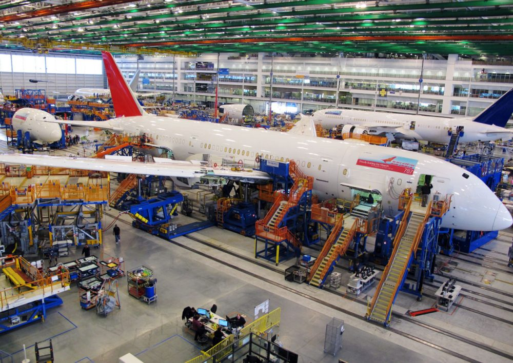 Workers assemble Boeing 787 Dreamliners in the company's massive assembly plant in North Charleston, S.C., Dec. 19, 2013. (Bruce Smith/AP)
