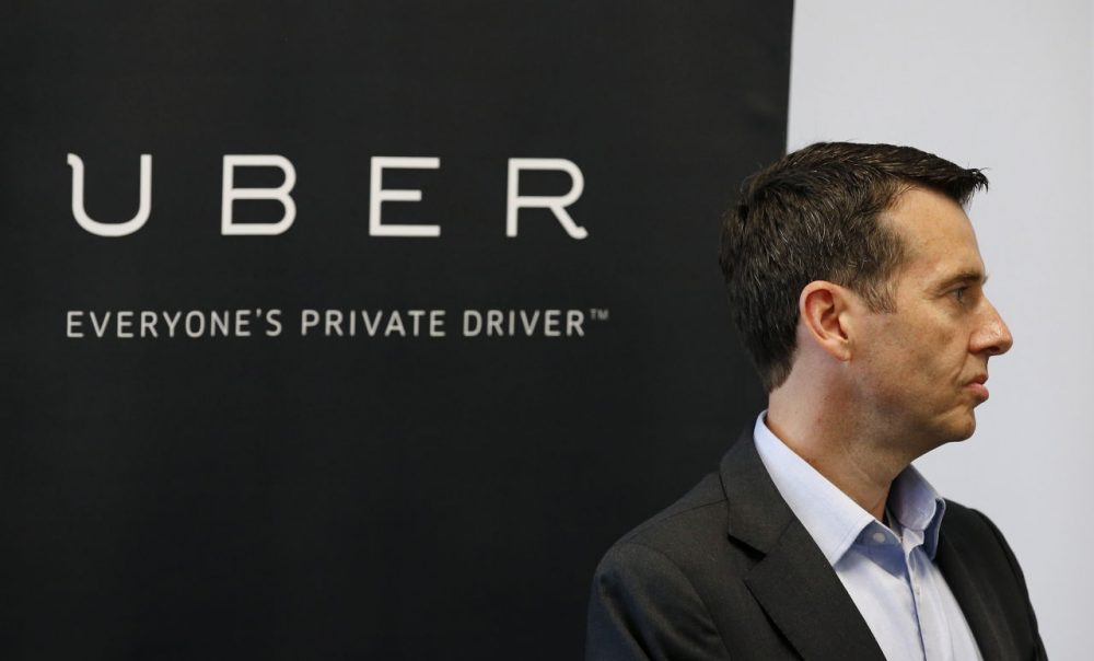 David Plouffe, Uber senior vice president of policy and communications, listens as Arizona Gov. Doug Ducey speaks at the opening of the new Uber offices Thursday, June 11, 2015, in Phoenix.  The ride-hailing firm opens their new customer service center that is expected to eventually have several hundred employees. (Ross D. Franklin/AP)