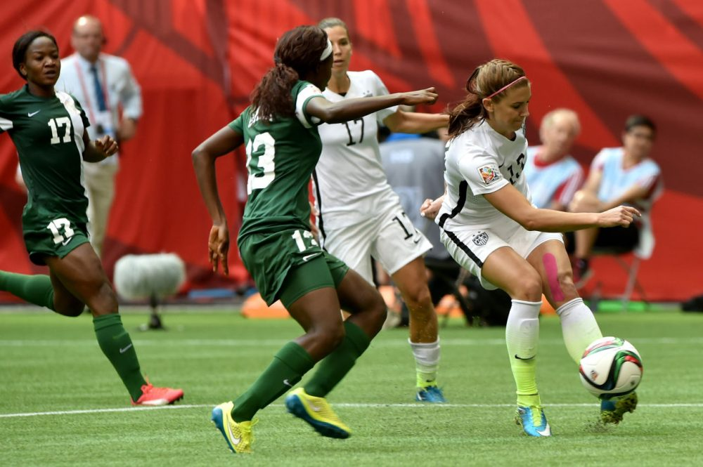 Alex Morgan #13 of the United States kicks the ball against Ngozi Okobi #13 of Nigeria in the second half in the Group D match of the FIFA Women's World Cup Canada 2015 at BC Place Stadium on June 16, 2015 in Vancouver, Canada. (Rich Lam/Getty Images)