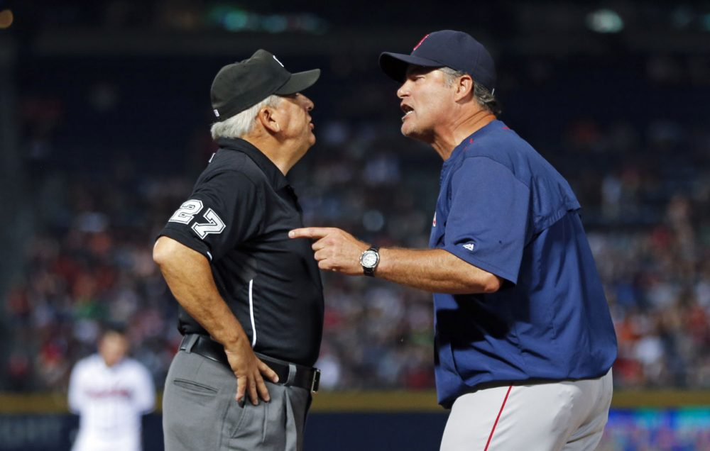 Boston Red Sox manager John Farrell (R) argues with umpire Larry Vanover in the seventh inning of a baseball game against the Atlanta Braves Wednesday, June 17, 2015, in Atlanta. (John Bazemore/AP)