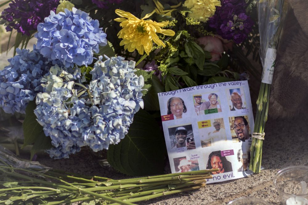 Flowers and notes of hope and support from the community line the sidewalk Friday in front of the Emanuel AME Church in Charleston, S.C. Dylann Storm Roof, 21, is accused of killing nine people during a Wednesday night Bible study at the church.  (Stephen B. Morton/AP)
