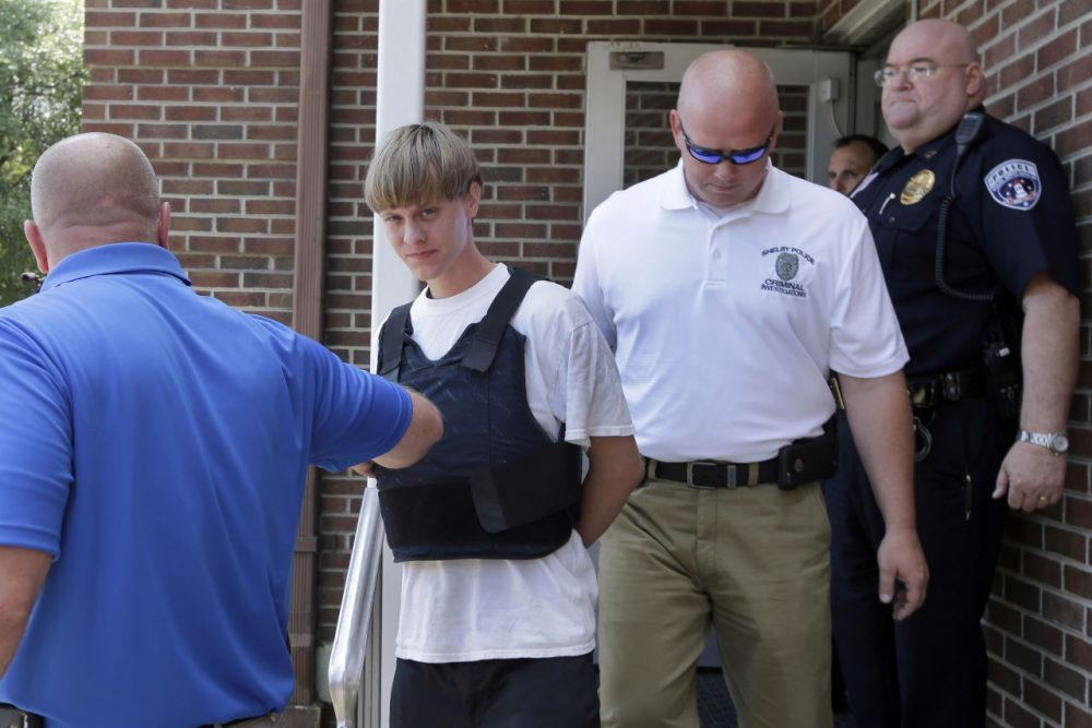 Charleston, S.C., shooting suspect Dylann Storm Roof, center, is escorted from the Shelby Police Department in Shelby, N.C., Thursday, June 18, 2015. Roof is a suspect in the shooting of several people Wednesday night at the historic The Emanuel African Methodist Episcopal Church in Charleston, S.C. (Chuck Burton/AP)