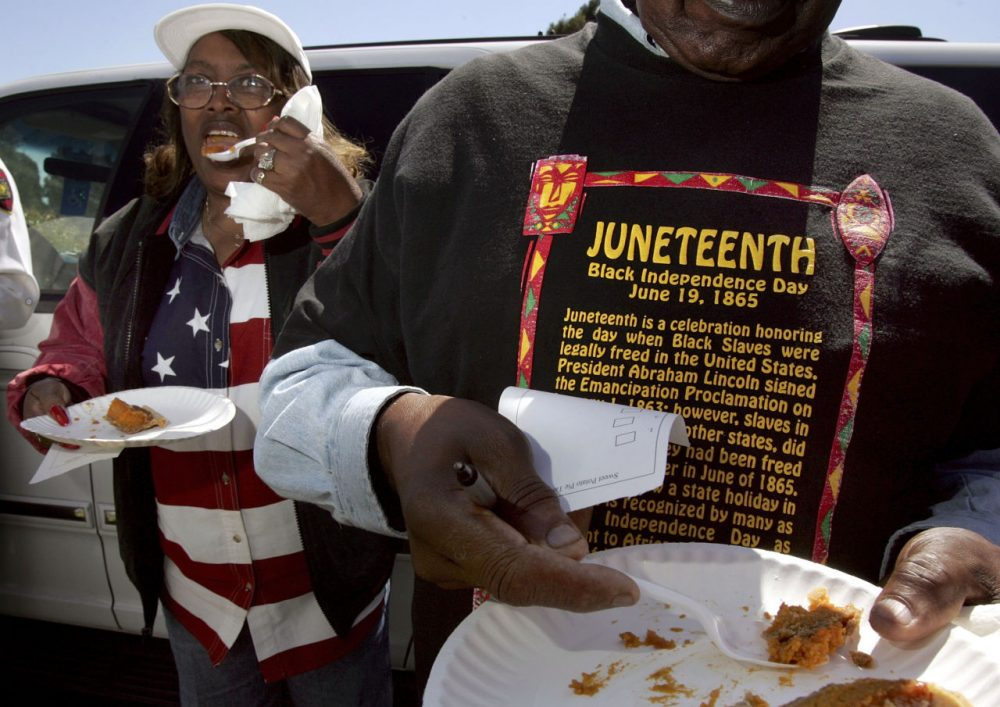 Naomi Williams (left) and D'Emanuel Grosse Sr. (right) taste the sweet potato pie entered in the cook-off contest at the Juneteenth, Black Independence Day celebrations at Nichol Park on June 19, 2004 in Richmond, California. The holiday is celebrated in June because slaves in Texas and several other states did not learn of their freedom until June of 1865. (David Paul Morris/Getty Images)
