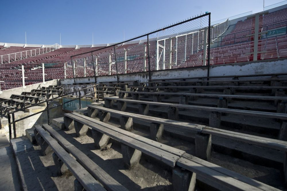 During Augusto Pinochet's rule of Chile, the National Stadium in Santiago served as a jail for prisoners. In remembrence of the tens of thousands of prisoners that were housed in the stadium, a section of seats remain the same as they were in Pinochet's dictatorship. The seats are always empty. (Martin Bernetti/AFP/Getty Images)