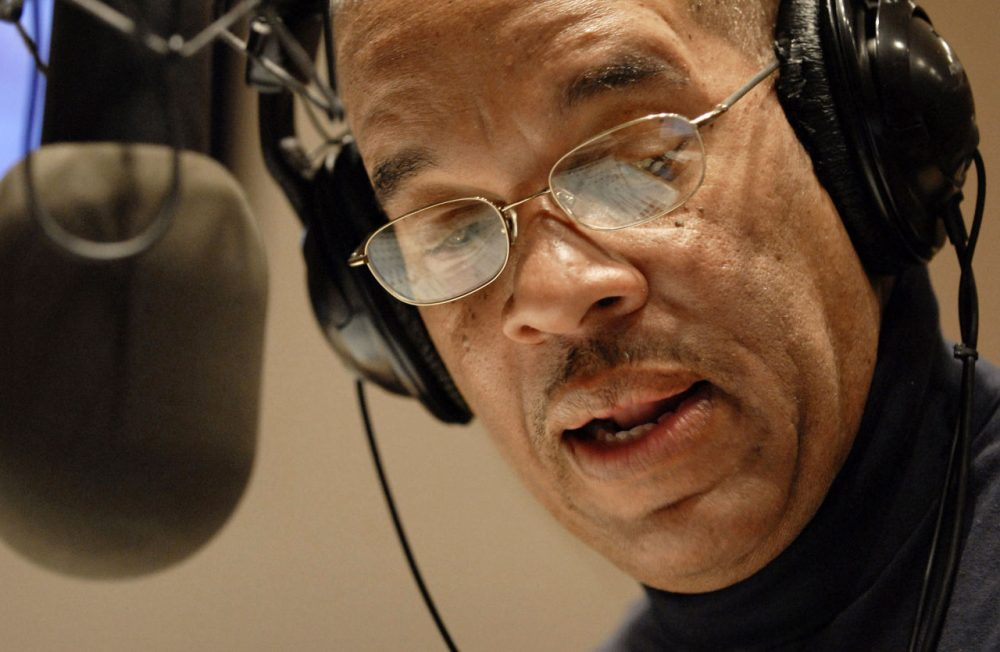 "Radio host Jose Masso introduces a song during the bilingual ""Con Salsa!"" radio show on WBUR 90.9 FM in Boston in 2009. (Josh Reynolds/AP)"