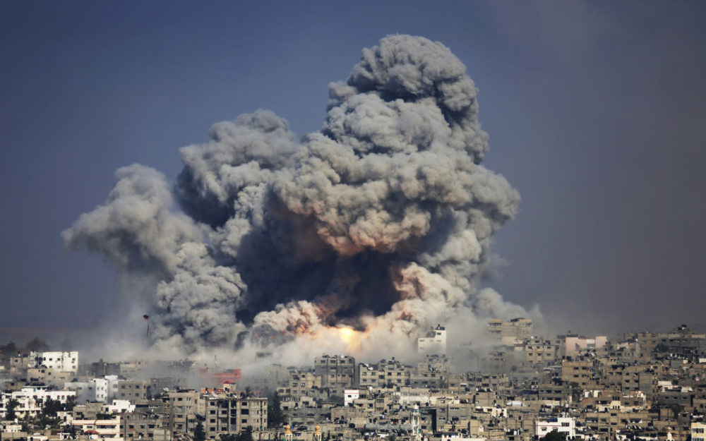 In this July 29, 2014 file photo, smoke and fire from an Israeli strike rise over Gaza City. (Hatem Moussa/AP)