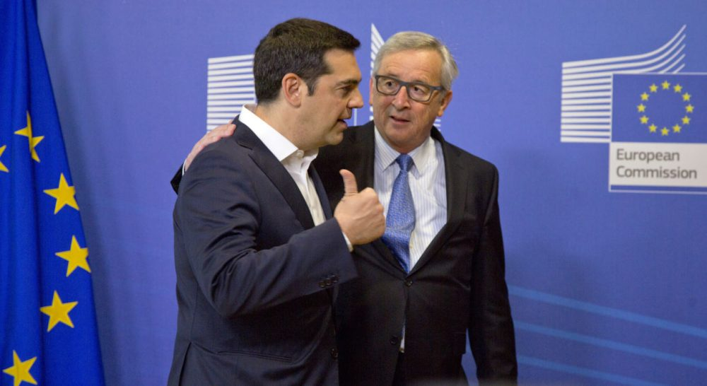 Greek Prime Minister Alexis Tsipras, left, speaks with European Commission President Jean-Claude Juncker as he arrives for a meeting prior to an EU summit at EU headquarters in Brussels on Monday, June 22, 2015. Heads of state in the eurogroup will meet in Brussels on Monday for a special summit to discuss the financial crisis with Greece. (Virginia Mayo/AP)