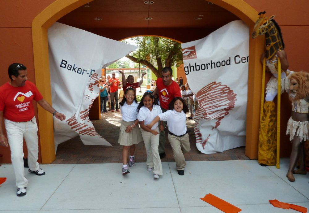 Students celebrate at the Baker-Ripley Grand Opening Festival in 2010. (Elmer Romero/Neighborhood Center's Inc./Flickr)