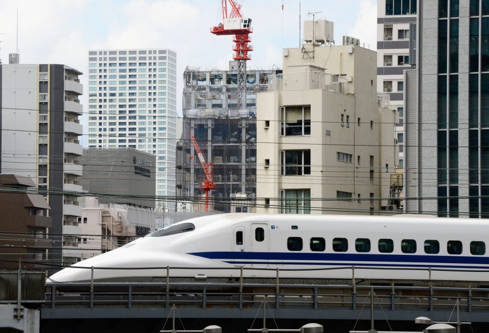 A 'shinkansen' or bullet train speeds past buildings in Tokyo on September 9, 2013. (Toro Yamanaka/AFP/Getty Images)