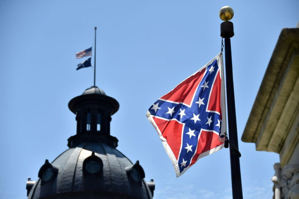 The South Carolina and American flags fly at half-staff behind the Confederate flag, in front of the State House in Columbia, South Carolina on June 19, 2015. (Mladen Antonov/AFP/Getty Images)