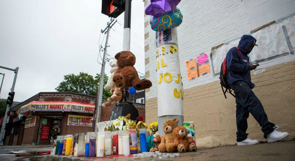 """Mark Culliton: """"Jobs programs for youth are important and powerful, but if we don't target the dropouts who exert a pull of their own, we won't stem the problem of youth violence in summer."""" Pictured: A pop up memorial for Jonathan Dos Santos on the corner of Washington and Fuller streets in Dorchester, Mass., where the 16-year-old was shot and killed on June 10, 2015. (Jesse Costa/WBUR)"""