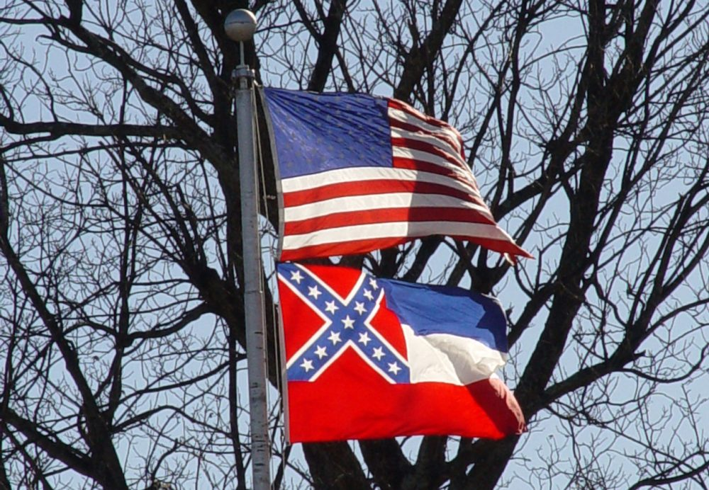 The Mississippi state flag flies under the American flag. (jimmysmith/Flickr)