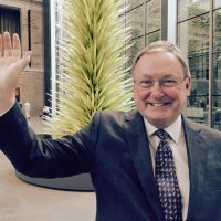 Malcolm Rogers waves farewell, standing in one of his favorite spots inside the MFA. (Andrea Shea/WBUR)