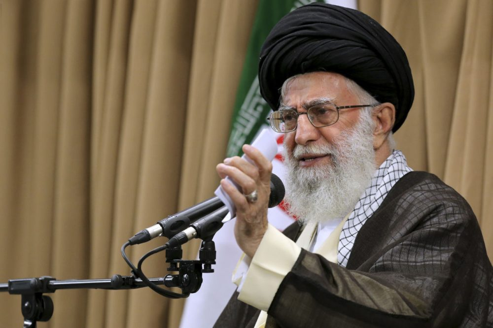 In this picture released by an official website of the office of the Iranian Supreme Leader on Tuesday, June 23, 2015, Supreme Leader Ayatollah Ali Khamenei addresses Iranian top officials in a mosque at his residence in Tehran, Iran. Iran's top leader has hardened his stance in nuclear negotiations with world powers as a deadline for a final deal rapidly approach, saying he rejects a long-term freeze on nuclear research and wants to ban international inspectors from accessing military sites. The comments by Khamenei, who repeatedly has backed the Islamic Republic's negotiators amid criticism from hard-liners, may give his diplomats little room for concessions ahead of the June 30 deadline. (Office of the Iranian Supreme Leader via AP)