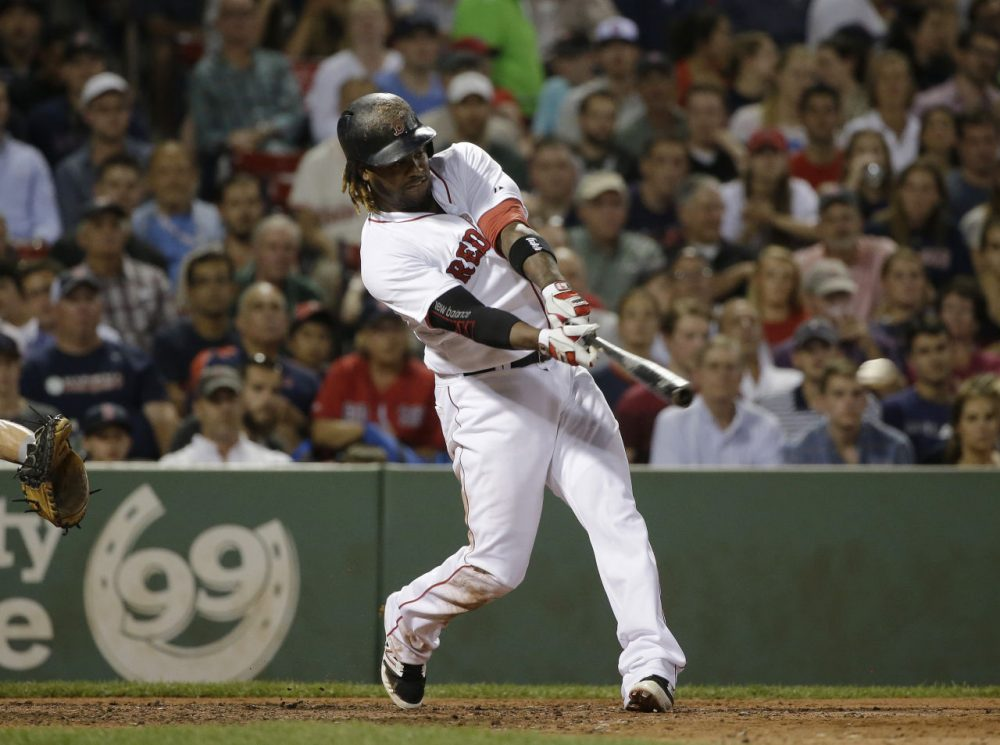 Boston Red Sox's Hanley Ramirez hits an RBI single in the fifth inning of a game at Fenway, Tuesday, June 23, 2015. (Steven Senne/AP)