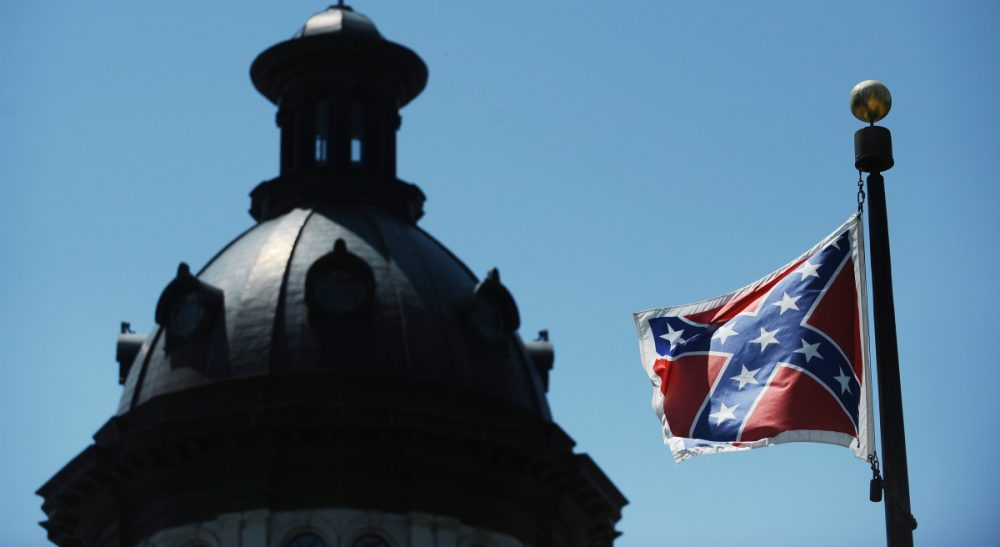 In this Friday, June 19, 2015 file photo, the Confederate flag flies near the South Carolina Statehouse, in Columbia. For years, lawmakers refused to consider removing the Confederate flag from Statehouse grounds, but opinions changed within days of the massacre of nine people at Emanuel African Methodist Episcopal church in Charleston. (Rainier Ehrhardt/AP)