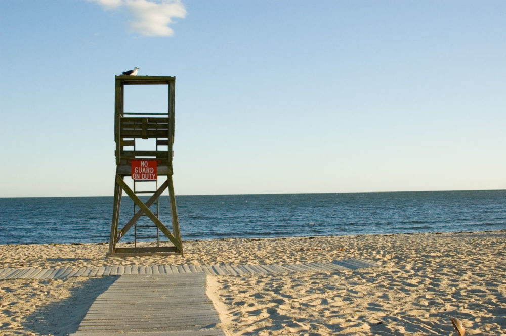 Lifeguards will be stationed at all DCR-run pools in Massachusetts this summer. But some beach-goers may need to swim at their own risks at times. (GmanViz/Flickr)
