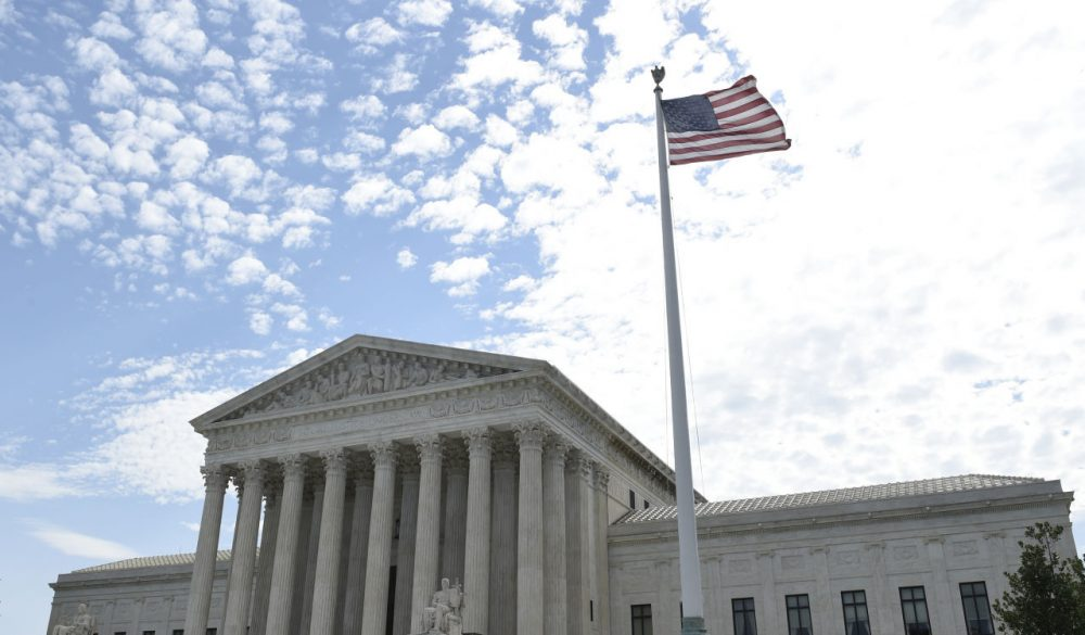 The flag flies in the wind in front of the Supreme Court in Washington, Monday, June 22, 2015. (Susan Walsh/AP)